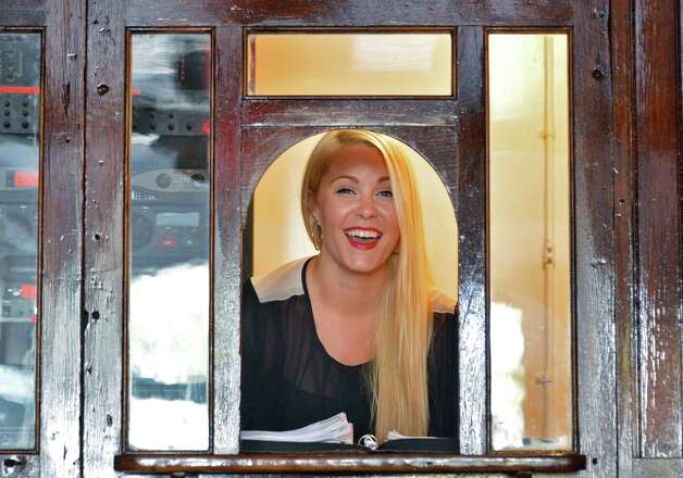 Events coordinator Emily Daniels in the 100-yr-old ticket window at the new Stand-Up Sit Down Restaurant, new headquarters of The Comedy Works in Albany Tuesday Sept. 11, 2012.   (John Carl D'Annibale / Times Union) Photo: John Carl D'Annibale / 00019183A