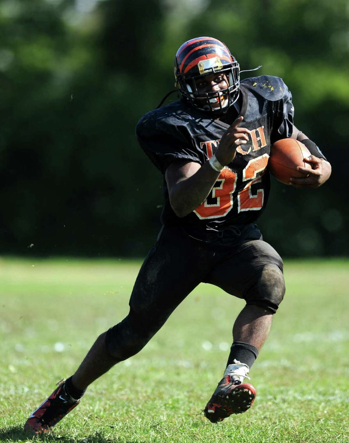 Bullard-Havens Technical School's John Shannon carries the ball on his way to a touchdown during their game against Prince Tech, of Hartford, Saturday, Oct. 8, 2011 at Bullard-Havens' campus in Bridgeport, Conn.