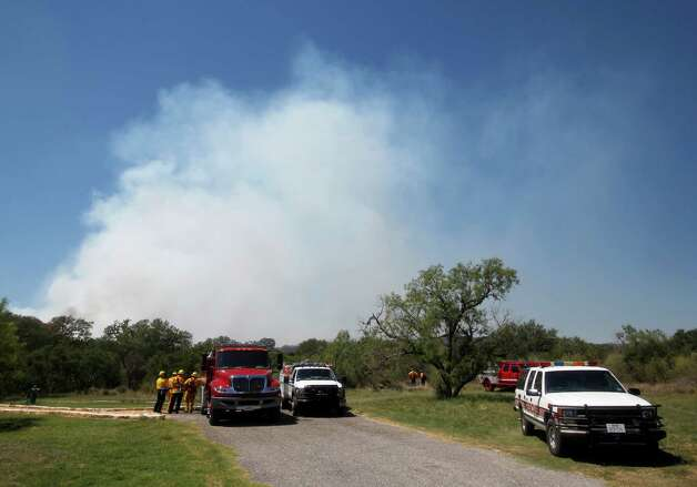Smoke from a prescribed burn in Government Canyon State Natural Area rises Tue., Sept. 11, 2012 as firefighters watch the perimeter and protect a nearby building. Photo: William Luther, San Antonio Express-News / © 2012 San Antonio Express-News