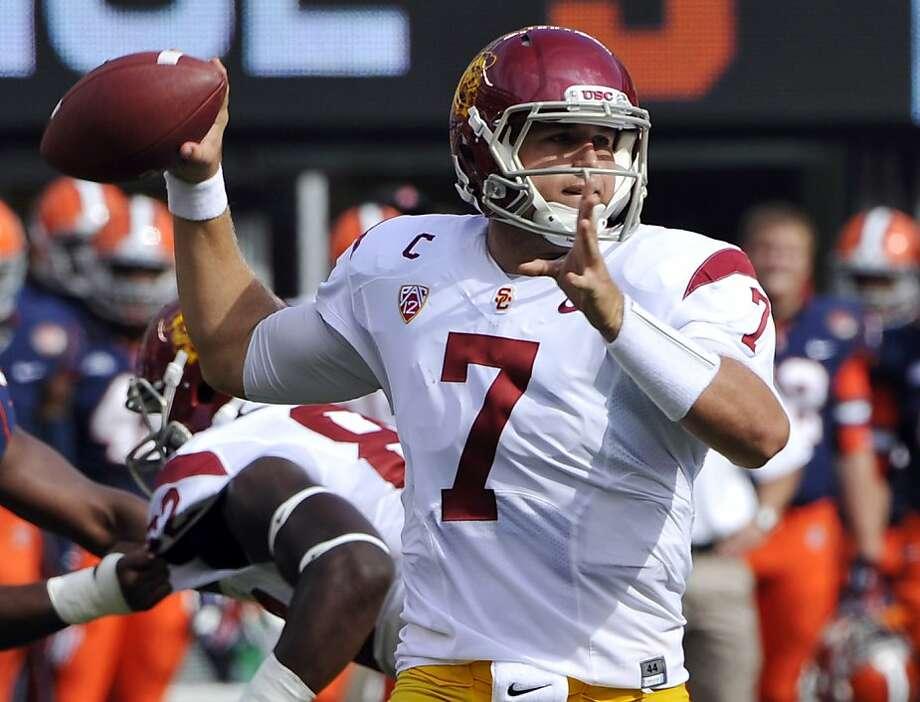 USC quarterback Matt Barkley tied the school record with six touchdown passes in a 42-29 win over Syracuse on Saturday. Photo: Bill Kostroun, Associated Press