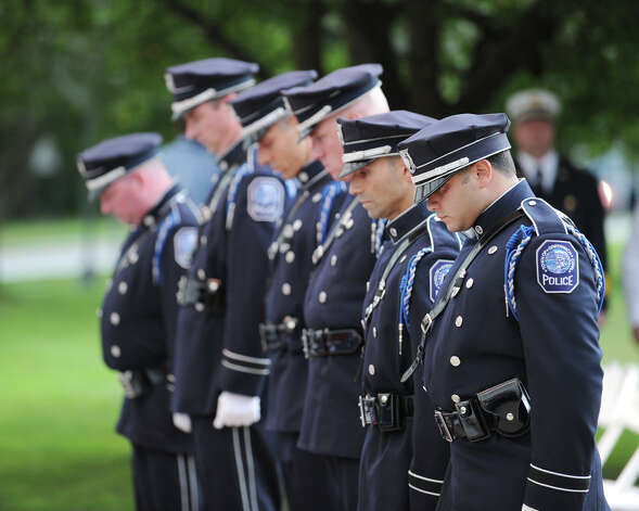 The Greenwich Police Department Honor Guard during the 9/11 remembrance ceremony at Greenwich Town Hall, Tuesday night, Sept. 11, 2012. Photo: Bob Luckey / Greenwich Time