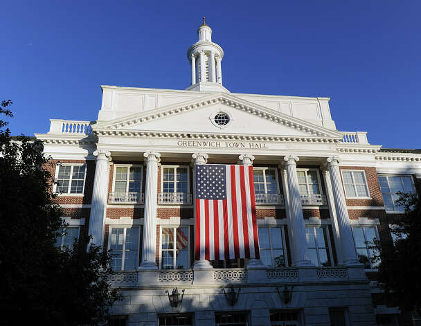 A giant American flag hangs on the front of Greenwich Town Hall during the 9/11 remembrance ceremony, Tuesday night, Sept. 11, 2012. Photo: Bob Luckey / Greenwich Time
