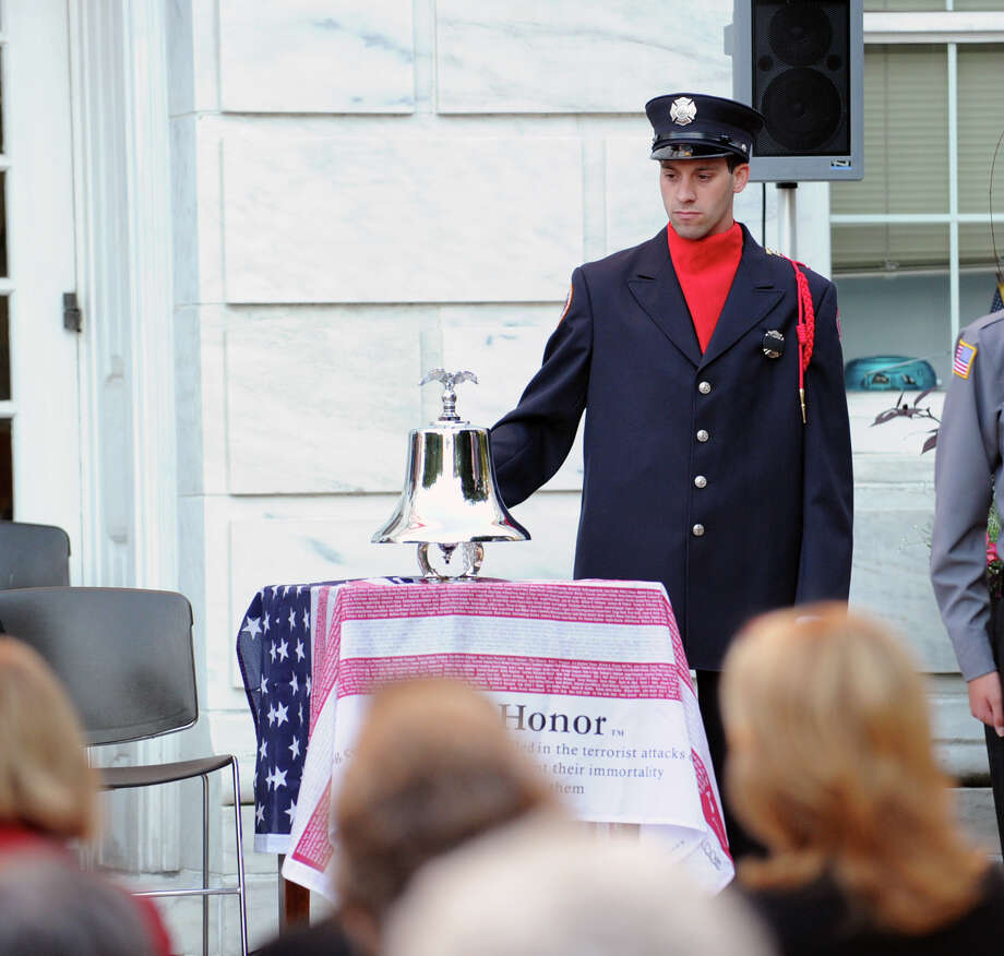 Greenwich Firefighter Matthew Gordiski rings a remembrance bell during the 9/11 remembrance ceremony at Greenwich Town Hall, Tuesday night, Sept. 11, 2012. Photo: Bob Luckey / Greenwich Time