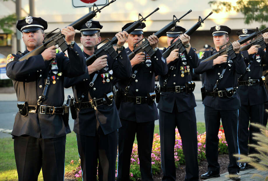 Members of thye Danbury Police Department Honor Guard give a 21-gun salute during the 9/11 memorial ceremony at Elmwood Park in Danbury on Sept. 11, 2012. Photo: Jason Rearick / The News-Times
