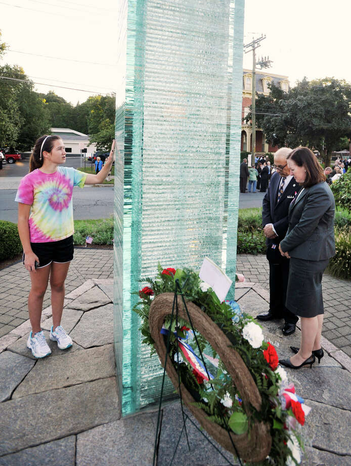 From left, Tara Ryan and Robert and Dianne Yamin look at the 9/11 memorial during the memorial ceremony at Elmwood Park in Danbury on Sept. 11, 2012. Photo: Jason Rearick / The News-Times