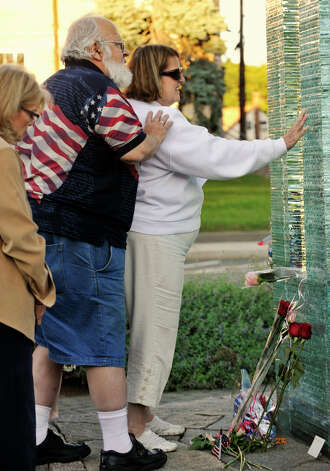 Bob Rowley looks over the shoulder of his wife, Emily, during the 9/11 memorial ceremony at Elmwood Park in Danbury on Sept. 11, 2012. The Rowleys lost their son-in-law, Robert Higley, in the terrorist attacks in 2001. Photo: Jason Rearick / The News-Times