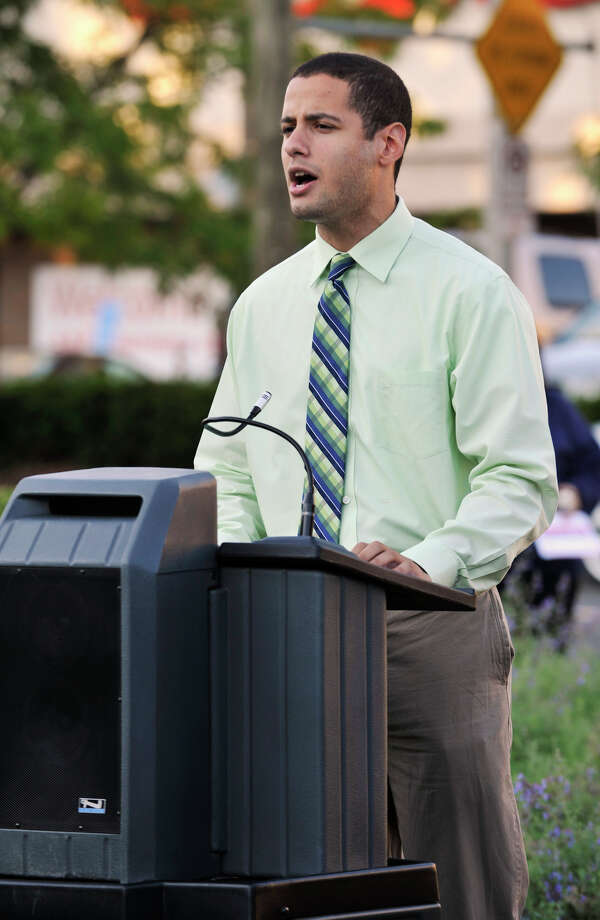 Erick Sanchez, a vocalist from Western Connecticut State University, sings the National Anthem during the 9/11 memorial ceremony at Elmwood Park in Danbury on Sept. 11, 2012. Photo: Jason Rearick / The News-Times