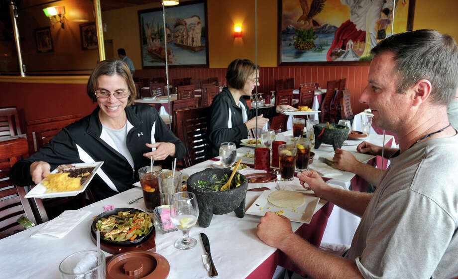 Barbara and Paul Kenny of New Fairfield have fajitas and guacamole for lunch at El Coyote Restaurant in Brookfield, Monday, Aug. 27, 2012. Photo: Carol Kaliff / The News-Times