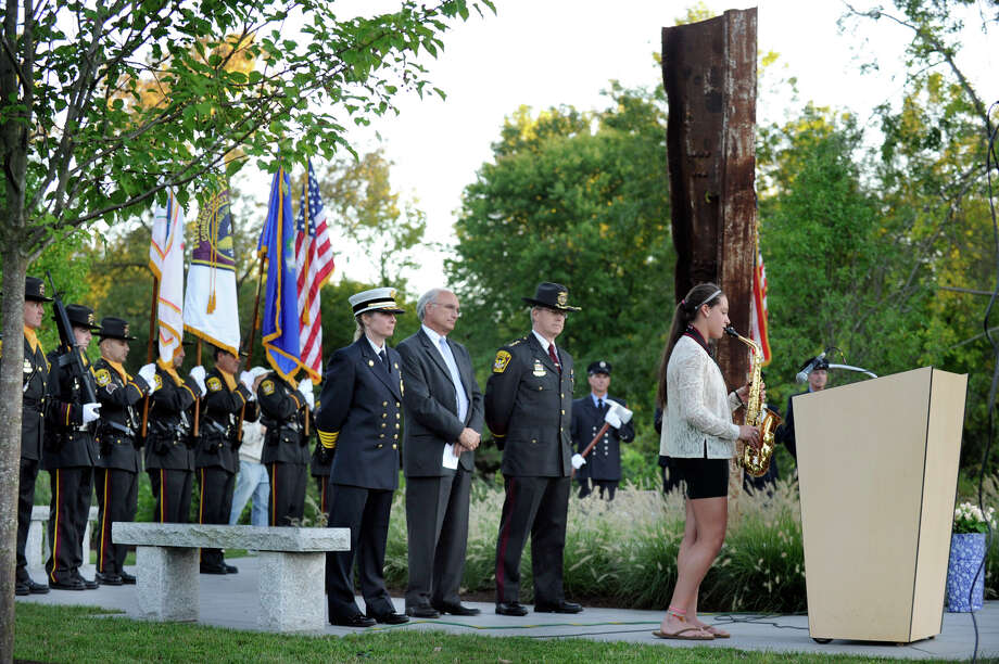 "Molly Weeks plays ""God Bless the U.S.A."" on an alto saxaphone during Ridgefield's 9/11 memorial ceremony Tuesday, Sept. 11, 2012. Photo: Carol Kaliff"