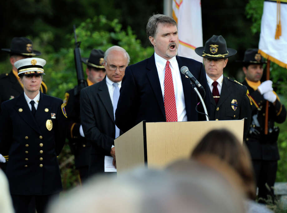 "William Joyner sings ""America the Beautiful"" during Ridgefield's 9/11 memorial ceremony Tuesday, Sept. 11, 2012. Photo: Carol Kaliff"