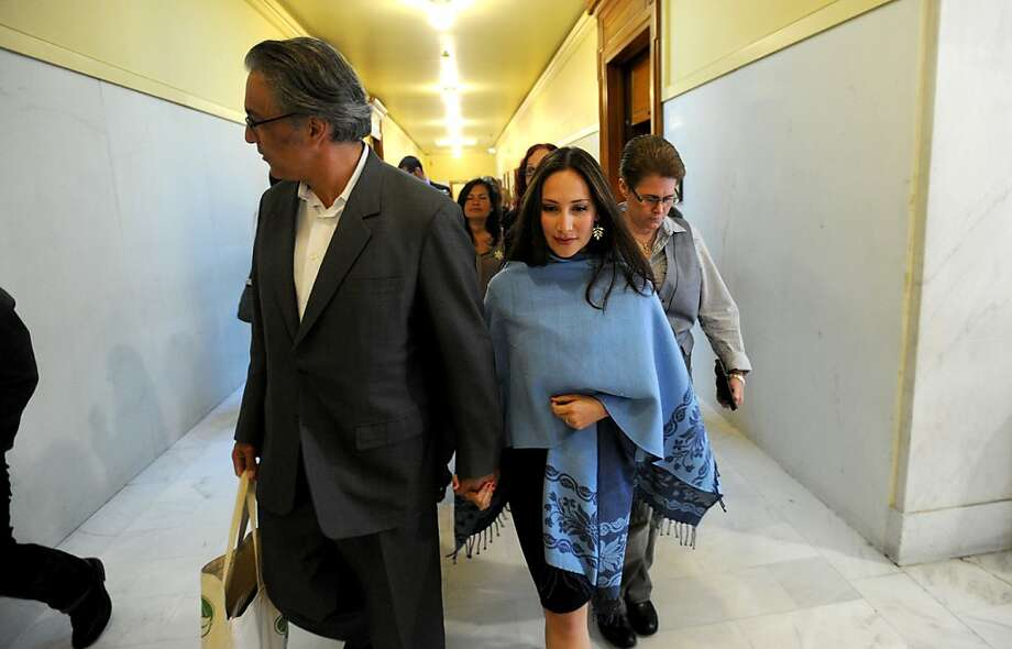 Suspended Sheriff Ross Mirkarimi and his wife Eliana Lopez leave an Ethics Commission meeting on Tuesday, Sept. 11, 2012, in San Francisco. Mirkarimi, accused of official misconduct in connection with a domestic violence case, unsuccessfully lobbied the commission to postpone proceedings until after the November election. Photo: Noah Berger, Special To The Chronicle