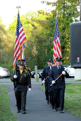 The Ridgefield Police Department Honor Guard and Ridgefield Volunteer Fire Department Color Guard prepare to march at the start of Ridgefield's 9/11 memorial ceremony Tuesday, Sept. 11, 2012. Photo: Carol Kaliff / The News-Times