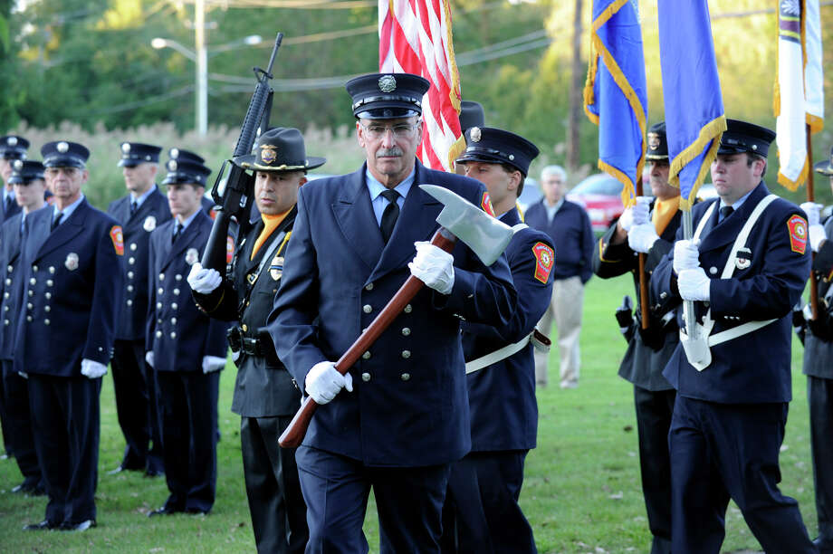 The Ridgefield Police Department Honor Guard and Ridgefield Volunteer Fire Department Color Guard march at the start of Ridgefield's 9/11 memorial ceremony Tuesday, Sept. 11, 2012. Photo: Carol Kaliff / The News-Times