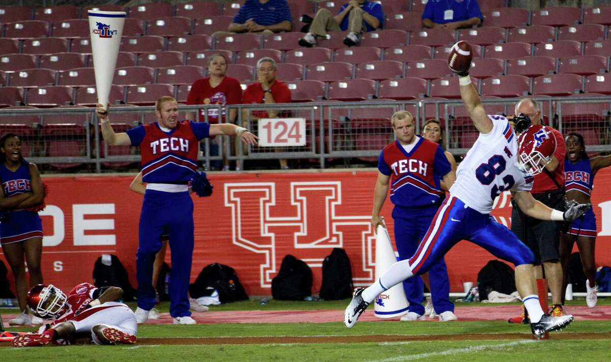 R.P. Stuart (83) and Louisiana Tech torched the UH defense to the tune of 56 points and 598 yards.