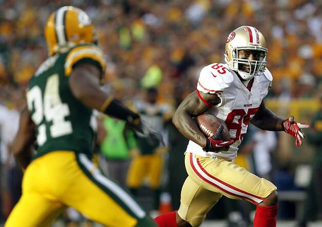 San Francisco 49ers' Vernon Davis (85) tries to break away from Green Bay Packers' Jarrett Bush (24) during the second half of an NFL football game Sunday, Sept. 9, 2012, in Green Bay, Wis. The 49ers won 30-22. (AP Photo/Mike Roemer) Photo: Mike Roemer, Associated Press