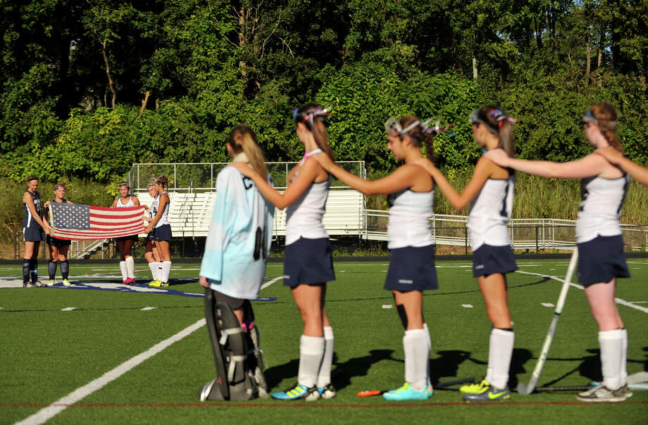 Immaculate High School field hockey players remember Candace Williams during a ceremony before their game against Morgan of Clinton at Immaculate High School in Danbury on Tuesday, Sept. 11, 2012. Williams was a victim in the terrorist attacks of 9/11. Photo: Jason Rearick / The News-Times