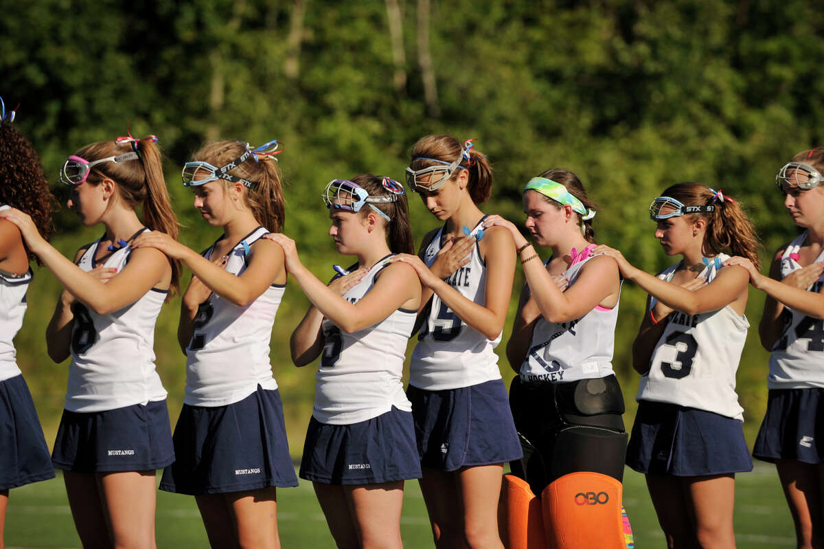 Immaculate High School field hockey players remember Candace Williams during a ceremony before their game against Morgan of Clinton at Immaculate High School in Danbury on Tuesday, Sept. 11, 2012. Williams was a victim in the terrorist attacks of 9/11.