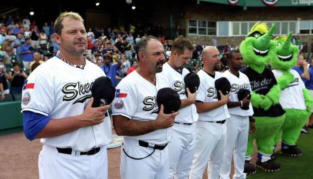Sugar Land Skeeters pitcher Roger Clemens, left, stands with manager Gary Gaetti, right, as the national anthem is played before the Skeeters' baseball game against the Bridgeport Bluefish Friday, Aug. 24, 2012, in Sugar Land, Texas. Clemens, a seven-time Cy Young winner, signed with the Skeeters of the independent Atlantic League this week and is expected to start for the minor league team Saturday at home against Bridgeport. (AP Photo/David J. Phillip) Photo: David J. Phillip, Associated Press / AP