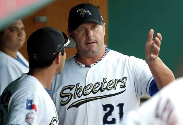 Sugar Land Skeeters pitcher Roger Clemens (21) talks with catcher Octavio Martinez, left, before the Skeeters' baseball game against the Bridgeport Bluefish on Friday, Aug. 24, 2012, in Sugar Land, Texas. Clemens, a seven-time Cy Young winner, signed with the Skeeters of the independent Atlantic League this week and is expected to start for the minor league team Saturday at home against Bridgeport. (AP Photo/David J. Phillip) Photo: David J. Phillip, Associated Press / AP