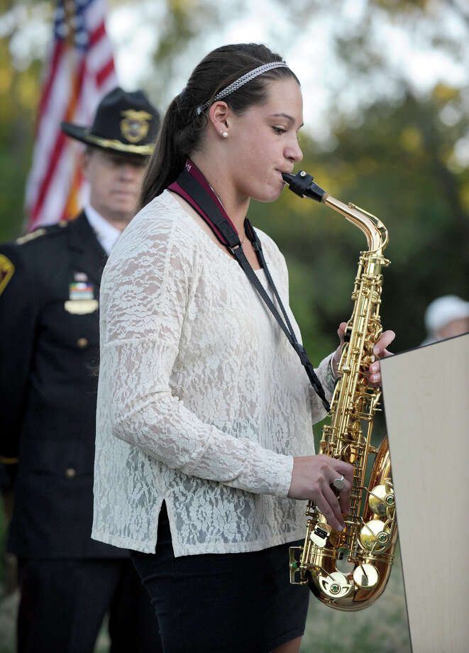 "Molly Weeks plays ""God Bless the U.S.A."" on an alto saxaphone during Ridgefield's 9/11 memorial ceremony Tuesday, Sept. 11, 2012. Photo: Carol Kaliff / The News-Times"