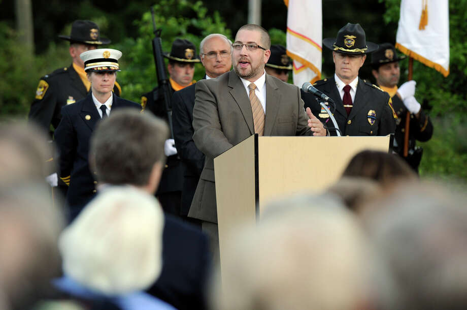 Pastor Dan Keaton, of the Ridgefield Baptist Church, speaks during Ridgefield's 9/11 memorial service Tuesday, Sept. 11, 2012. Photo: Carol Kaliff / The News-Times