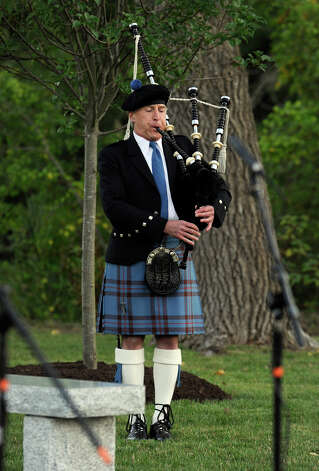 Tom Elliott plays Amazing Grace on the bagpipes in memory of police officers lost during the 9/11 terroist attacks on the World Trade Center during Ridgefield's Sept. 11 memorial ceremony Tuesday, Sept. 11, 2012. Photo: Carol Kaliff / The News-Times