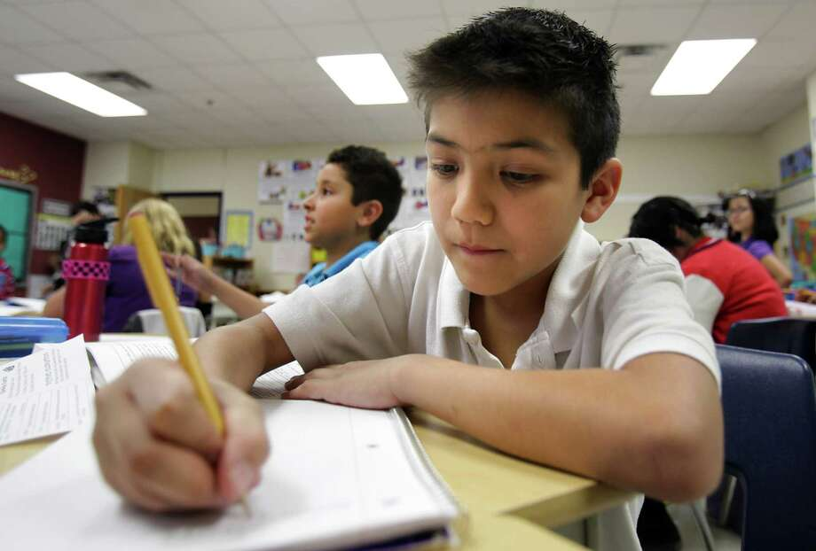 "Sebastien De La Cruz, a finalist  on ""America's Got Talent"",  works on an assignment in Miss Pleak's 5th grade class at Salinas Elementary School in Judson ISD,  Tuesday, Sept. 11, 2012. Photo: BOB OWEN, San Antonio Express-News / © 2012 San Antonio Express-News"