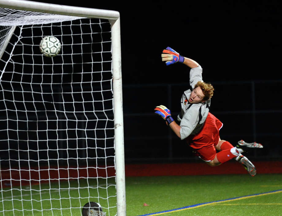 Greenwich goalie Emmett Clarke can't stop a shot by Norwalk's #10 Santiago Muriel, during boys soccer action in Norwalk, Conn. on Tuesday September 11, 2012. Photo: Christian Abraham / Connecticut Post
