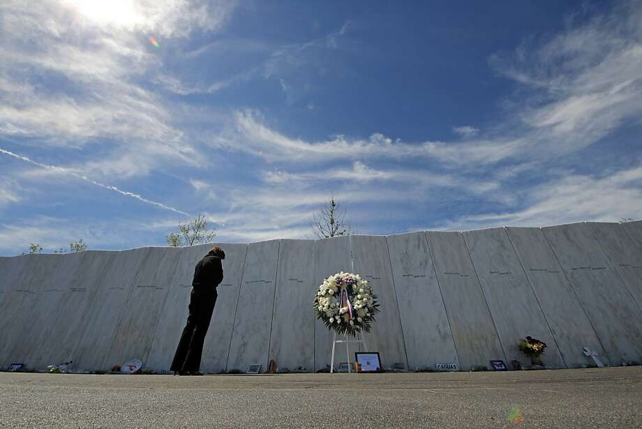 Visitors to the Flight 93 National Memorial pause at The Wall of Names, containing the names of the 40 passengers and crew who died in the crash of United Flight 93 following a memorial service in Shanksville, Pa., Tuesday, Sept. 11, 2012. Photo: Gene J. Puskar, Associated Press