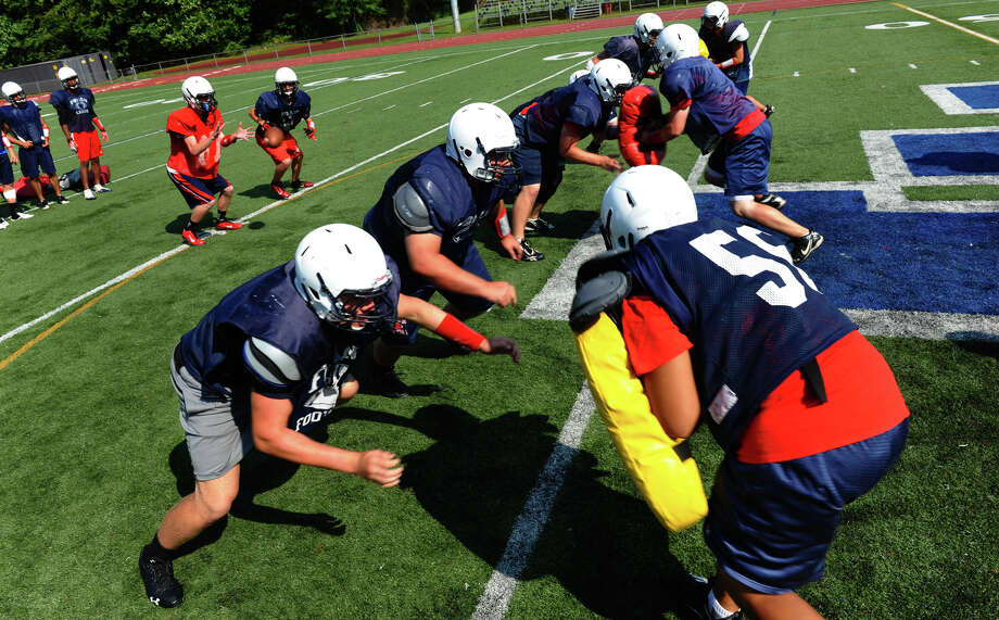 Foran High School football practice in Milford, Conn. on Wednesday August 30, 2012. Photo: Christian Abraham / Connecticut Post