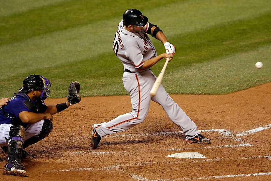 Madison Bumgarner didn't pitch long enough to earn a win, but he hits a game- tying three-run homer in the fourth inning on an adventurous night in Denver. Photo: Doug Pensinger, Getty Images