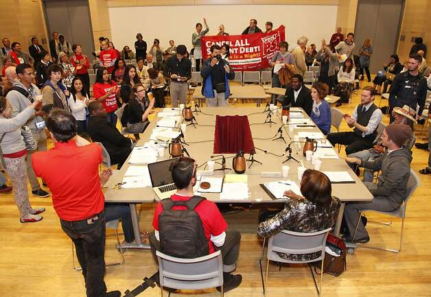 Students and community members take over a CCSF Board of Trustees meeting on Tuesday, Sept. 11, 2012 at the City College of San Francisco's chinatown campus. The board of trustees decided to ask the state for a special trustee to help them preserve their accreditation which many have opposed. Photo: Alex Washburn, Special To The Chronicle