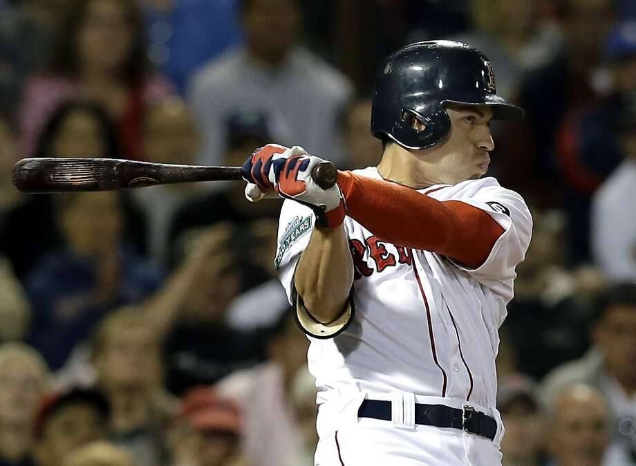 Boston Red Sox's Jacoby Ellsbury hits a game-winning RBI single against the New York Yankees in the ninth inning. Photo: Elise Amendola, Associated Press