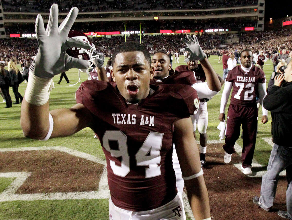 """Texas A&M defensive tackle Damontre Moore (94) symbols the Texas A&M """"Wrecking Crew"""", which is the name for a legendary defense that once played at the school, after the defense held Oklahoma to three goal line stops in a 33-19 upset victory in an NCAA Football game between Texas A&M and Oklahoma at Kyle Field on Saturday, Nov. 6, 2010, in College Station. ( Julio Cortez / Houston Chronicle )"""