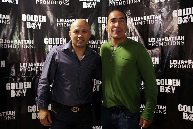 Leija Battah Promotions' Jesse James Leija (left) and Mike Battah at a press conference introducing boxers Antonio Escalante and Rocky Juarez at Champion Fit Gym, Tuesday, Sept. 11, 2012. Escalante and Juarez will be the main card at the boxing event on Oct. 27 at the Freeman Coliseum. Photo: Jerry Lara, San Antonio Express-News / © 2012 San Antonio Express-News