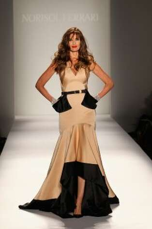 Pretty, but maybe too practical. Pockets are useful, but maybe they could have gone inside the dress? Model Carol Alt shines in this number in the Norisol Ferrari Spring 2013 fashion show during Mercedes-Benz Fashion Week at The Studio at Lincoln Center on September 10, 2012, in New York City. (Neilson Barnard / Getty Images for Mercedes-Benz Fashion Week)