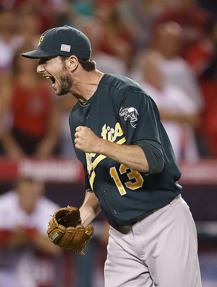 Oakland Athletics relief pitcher Jerry Blevins celebrates his team's 6-5 win against the Los Angeles Angels after a baseball game in Anaheim, Calif., Tuesday, Sept. 11, 2012. (AP Photo/Jae C. Hong) Photo: Jae C. Hong, Associated Press