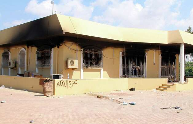 A burned building is seen inside the US Embassy compound on Wednesday  in Benghazi, Libya, following an overnight attack on the building. The US ambassador to Libya and three of his colleagues were killed in an attack on the US consulate in the eastern Libyan city by Islamists outraged over an amateur American-made Internet video mocking Islam, less than six months after being appointed to his post.   ( STRINGER/AFP/GettyImages) Photo: STRINGER, Ap/getty / 2012 AFP