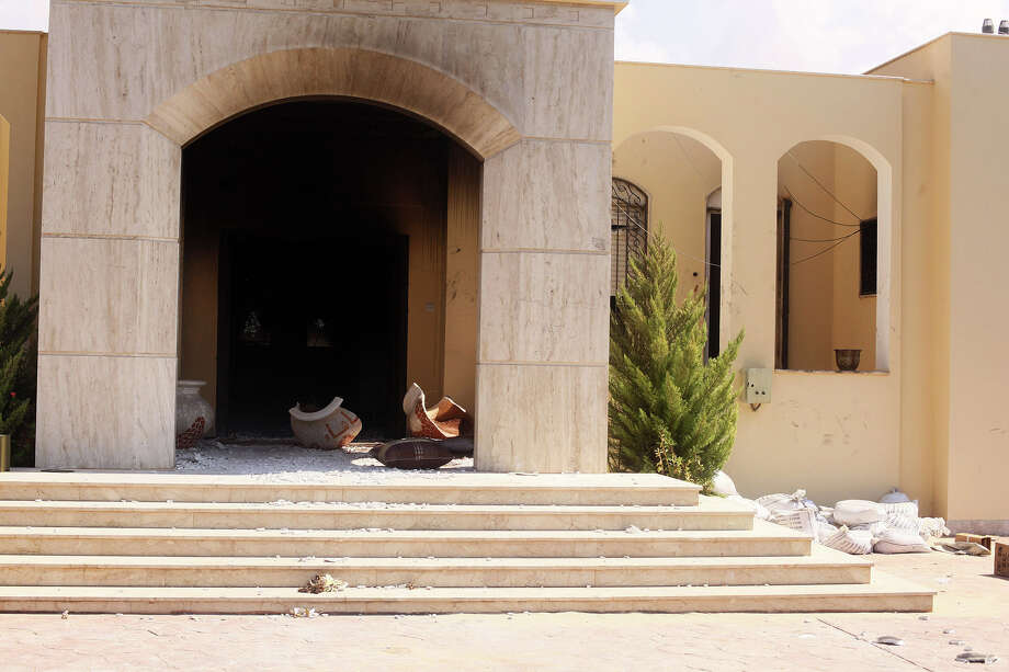 Damages after an attack on the U.S. Consulate by protesters angry over a film that ridiculed Islam's Prophet Muhammad in Benghazi, Libya, Wednesday. The U.S. ambassador to Libya and three other Americans were killed. (AP Photo/Ibrahim Alaguri) Photo: Ap/getty