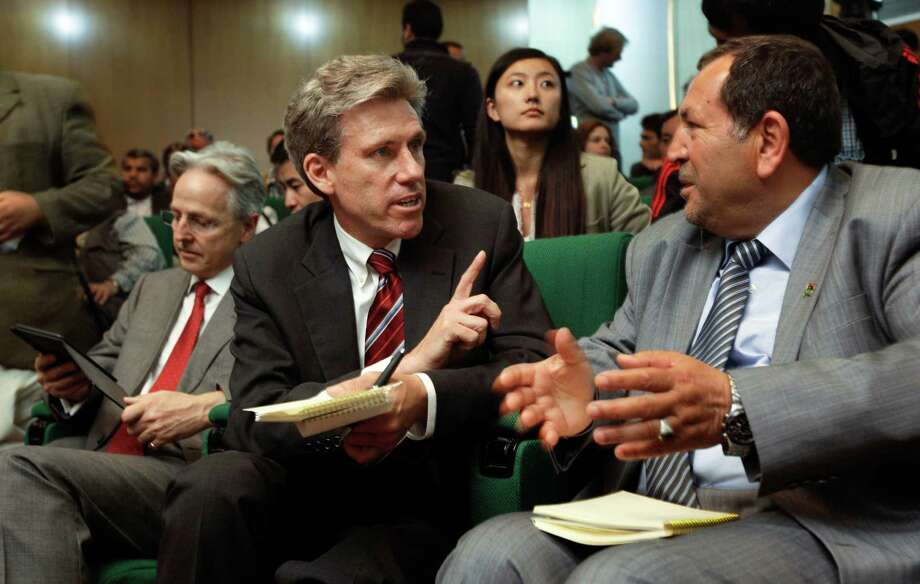 U.S. envoy Chris Stevens, center, accompanied by British envoy Christopher Prentice, left, speaks to Council member for Misrata Dr. Suleiman Fortia, right, at the Tibesty Hotel where an African Union delegation was meeting with opposition leaders in Benghazi, Libya on Monday, April 11, 2011. Libyan officials say the U.S. ambassador and three other Americans have been killed in an attack on the U.S. consulate in the eastern city of Benghazi by protesters angry over a film that ridiculed Islam's Prophet Muhammad. The officials say Ambassador Chris Stevens was killed Tuesday night when he and a group of embassy employees went to the consulate to try to evacuate staff. The protesters were firing gunshots and rocket propelled grenades. (AP Photo/Ben Curtis) Photo: Ap/getty