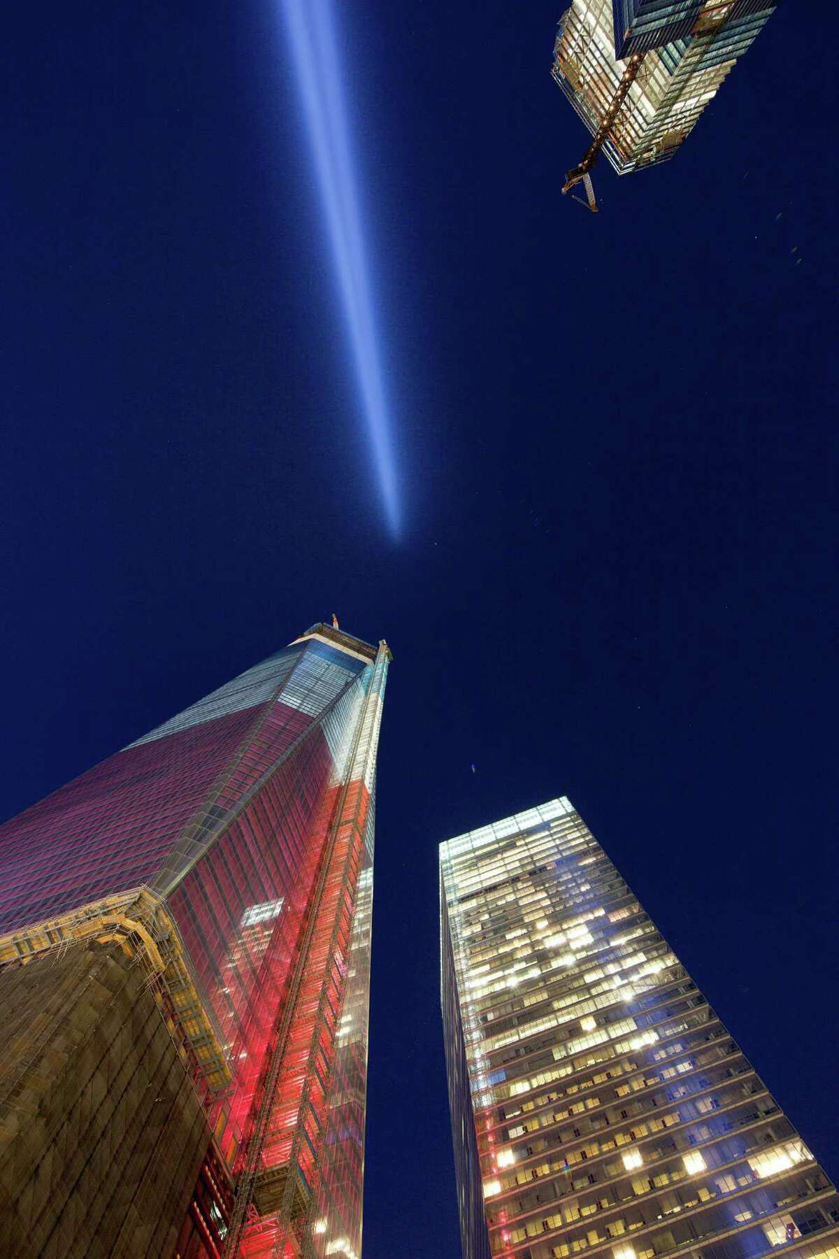 The Tribute in Light shines above 1 World Trade Center, left, and 7 World Trade Center, Tuesday, Sept. 11, 2012 in New York. Today marks the 11th anniversary of the terrorist attacks of Sept. 11, 2001.