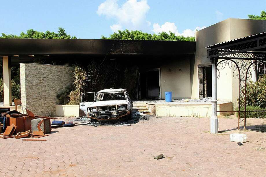 A burned house and a car are seen inside the US Embassy compound on Wednesday  in Benghazi, Libya following an overnight attack on the building. The US ambassador to Libya and three of his colleagues were killed in an attack on the US consulate in the eastern Libyan city by Islamists outraged over an amateur American-made Internet video mocking Islam, less than six months after being appointed to his post.  ( STRINGER/AFP/GettyImages) Photo: STRINGER, Ap/getty / 2012 AFP