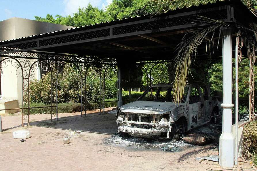 The wreckage of a car sits inside the US Embassy compound on Wednesday in Benghazi, Libya, following