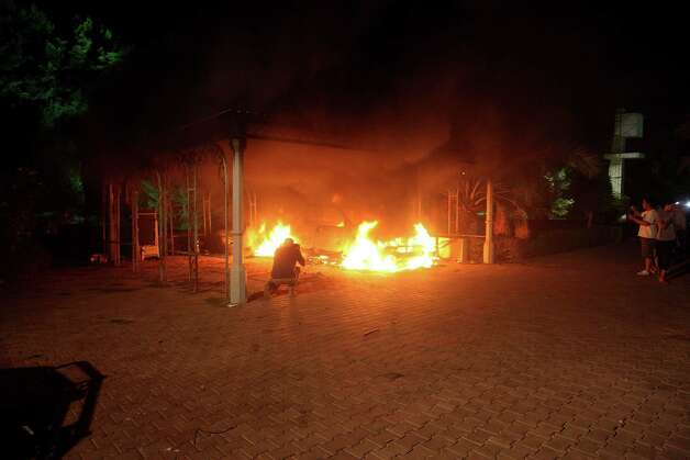 A vehicle and the surrounding area are engulfed in flames after it was set on fire inside the US consulate compound in Benghazi late on Tuesday. An armed mob protesting over a film they said offended Islam, attacked the US consulate in Benghazi and killed the US ambassador and three other Americans.       ( STR/AFP/GettyImages) Photo: STR, Ap/getty / 2012 AFP