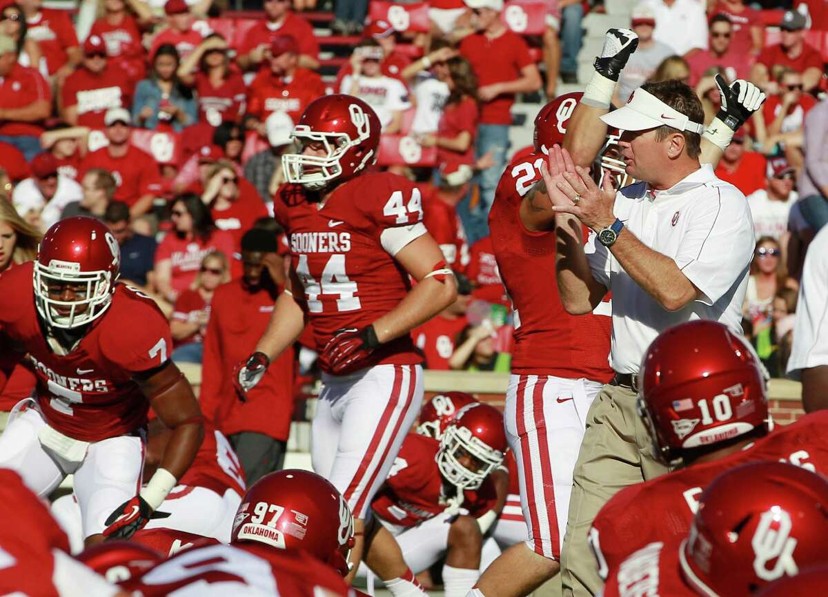 Oklahoma head coach Bob Stoops cheers his players on before the start of an NCAA college football game against Florida A&M in the Gaylord Family Memorial Stadium in Norman, Okla., Saturday, Sept. 8, 2012. (AP Photo/Sue Ogrocki)