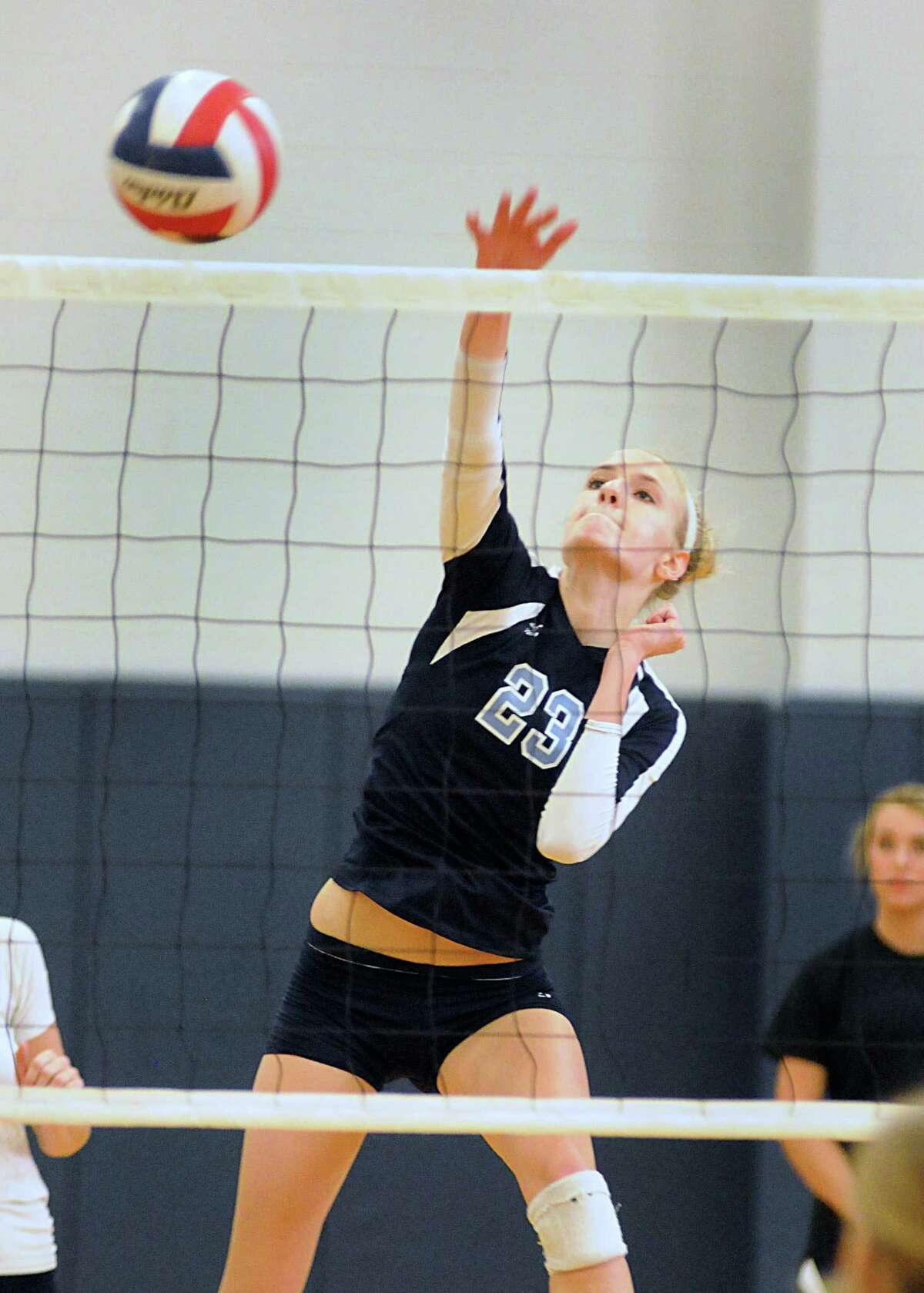 Kingwood's Madison McClurg spikes the ball during a recent match against Klein Collins.