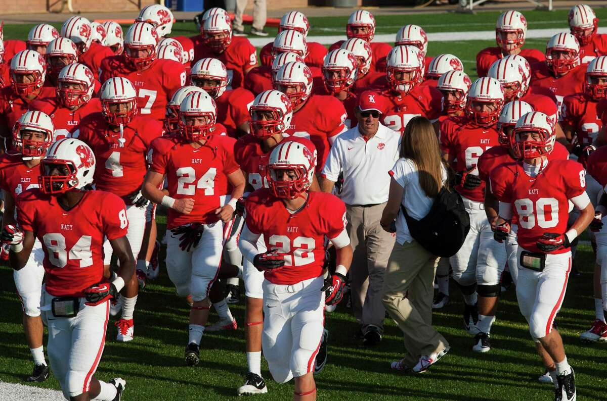 Head football coach Gary Joseph (white shirt) and the Katy Tiger football team walk off the field after warm ups as they prepare to face Alief Taylor at Rhodes Stadium on Friday, Sept. 7, 2012, in Katy. ( J. Patric Schneider / For the Chronicle )