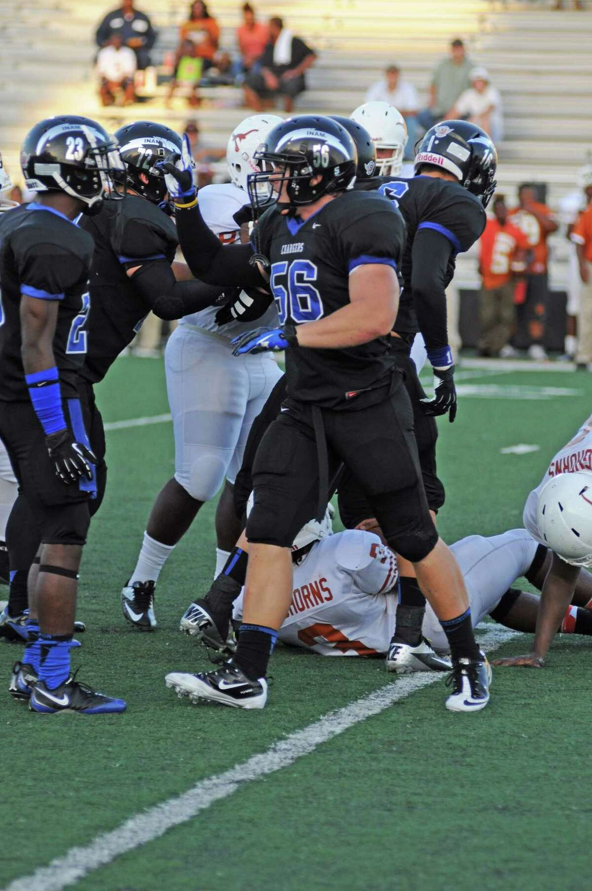 Clear Springs senior defender Cameron Doubenmier, No. 56, gets his fellow Chargers fired up after making a tackle during a recent non-district game against Dobie at Clear Creek ISD Veterans Memorial Stadium.