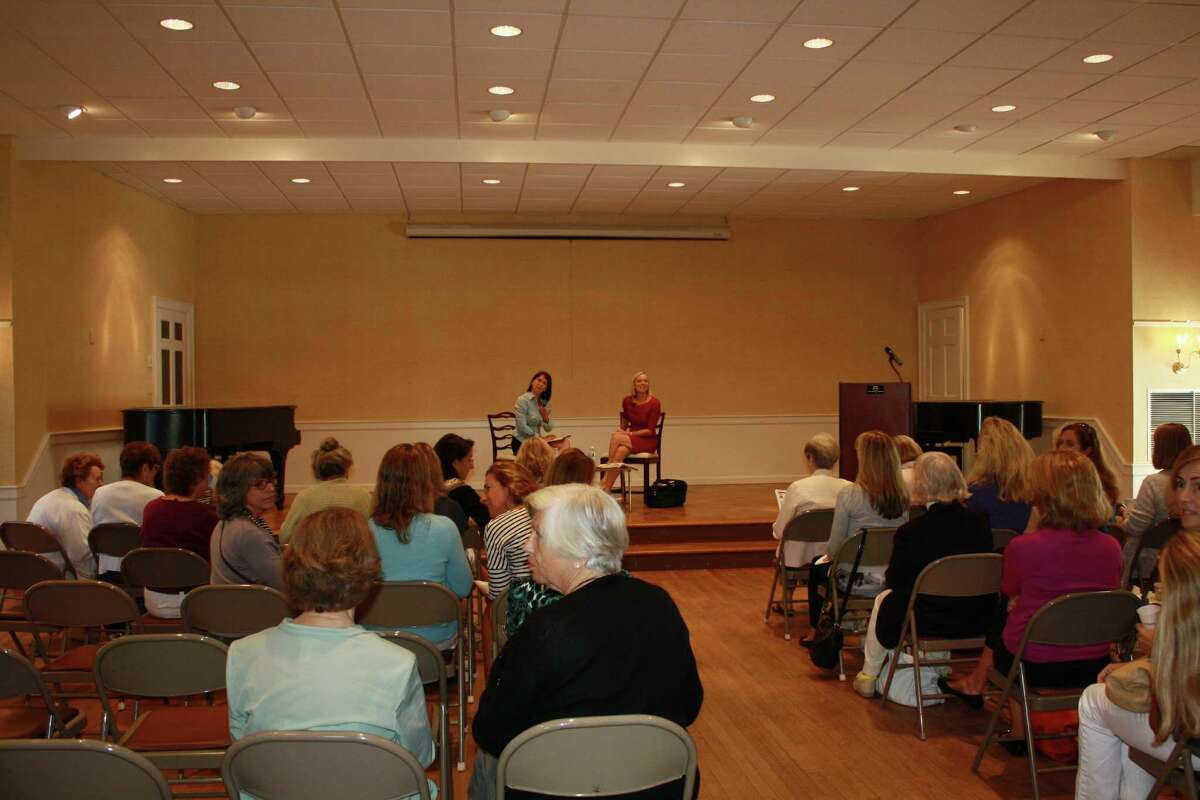 Darien residents gather to hear Lee Woodruff speak about her new book, Those We Love Most, at the Darien Community Assication in Darien, Conn on Sept. 11. Sept. 11, 2012
