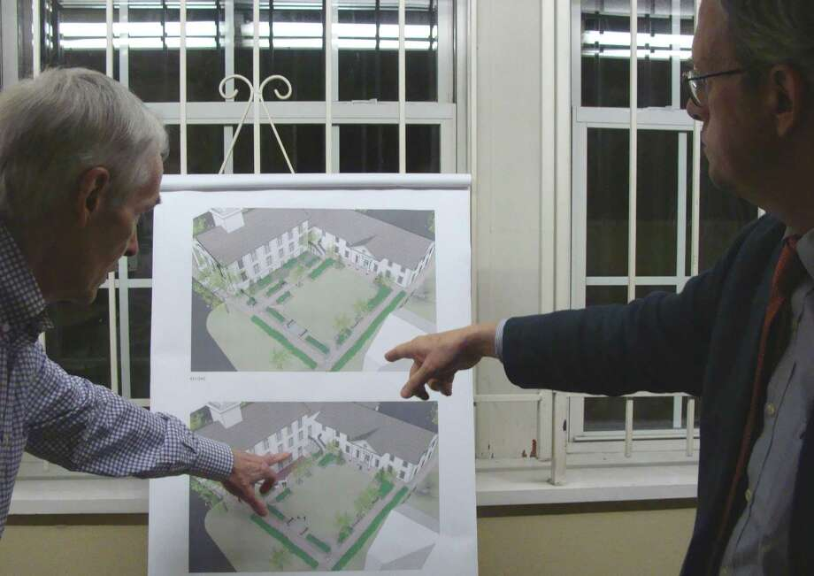 John Walsh, left, chairman iof the Saugatuck Congregational Church board of trustees, and architect Paul Bailey on Tuesday point out features of the garden and Hoskins Hall proposed during reconstruction of the fire-damaged church. Photo: Meg Barone / Westport News freelance